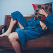 Man in dressing gown hiding behind cushion — Stock Photo