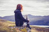 Woman relaxing on mountain top — Stock Photo
