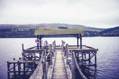 Pier at lake on gloomy day — Stock Photo
