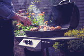Man cooking meat on barbecue — Stock Photo