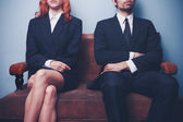 Man and woman waiting to enter a job interview — Stock Photo