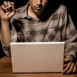 Stock Photo: Cigarette smoking man working on laptop
