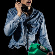 Blue collar worker on the phone — Stock Photo