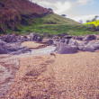 Rocky cliffs on beach — Stock Photo #35045053