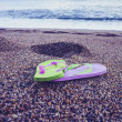 Flip flop sandals on the beach — Stock fotografie