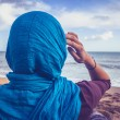 Rear view of woman with headscarf looking at the sea — Stock Photo