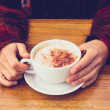 Woman in wool jumper drinking coffee on cold day — Stock Photo