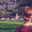 Woman looking at fairytale houses — Stock Photo