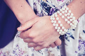 Woman's hands wearing a pearl bracelet — Foto de Stock