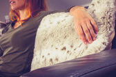 Woman relaxing on a sofa — Stock Photo