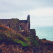 Ruin on cliff by the sea — Stock Photo