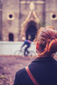 Rear view of woman looking at church — Stock Photo