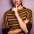 Young woman gesturing hush with her finger on her lip — Stock Photo