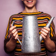 Happy young woman holding metal watering can — Stock Photo