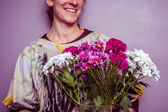 Happy young woman with bouquet of fresh flowers — Stock Photo