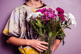 Young woman with bouquet of fresh flowers — Stock Photo