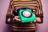Young woman with old rotary phone — Stock Photo