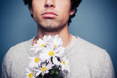 Sad and rejected man with a bouquet of flowers — Stock Photo