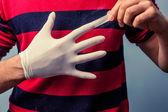 Man removing latex glove — Stock Photo