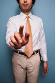 Young man in shirt and tie pushing button — Stockfoto