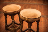 Two antique stools — Stock Photo