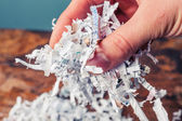 Hand with shredded paper — Stock Photo