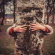 Stock Photo: Womhugging tree