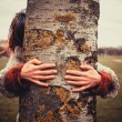 Woman hugging a tree — Stock Photo #41373323