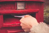 Woman posting letter — Stock Photo