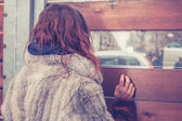 Young woman looking out — Stock Photo