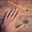 Stock Photo: Hand and pencil
