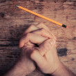 Stock Photo: Praying hands and pencil
