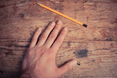 Hand and pencil — Stock Photo