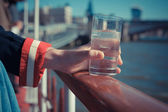 Relaxing with drink of water on a boat — Stock Photo