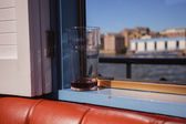 Pint glass by window on a boat — Stock Photo