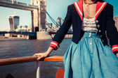 Woman touring the Thames on a boat — Stock Photo