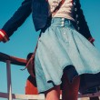 Young woman on the deck of ship with skirt blowing in the wind — Stock Photo #43090683