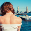 Young woman admiring the River Thames — Stock Photo
