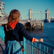 Young woman standing on the bank of the Thames in London — Stock Photo #43093879
