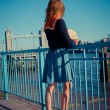 Young woman standing on the bank of the Thames in London — Stock Photo #43094119