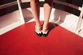 Woman's feet and shoes on the deck of a ship — Stock Photo
