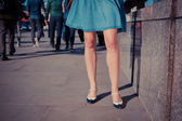 Young woman standing in the street — Stock Photo