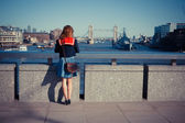 Young woman admiring London skyline — Stock Photo