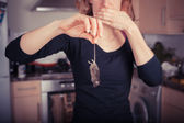 Woman with dead mouse in kitchen — Stock Photo