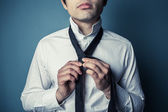 Young man tying his tie — Stock Photo
