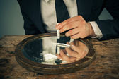 Businessman snorting cocaine — Stock Photo