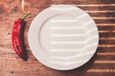 Red pepper and a plate — Stock Photo