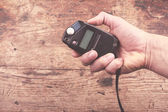 Hand with light meter — Stock Photo