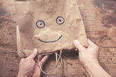 Smiling face on paperbag — Stock Photo