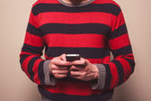 Young man using smart phone — Stock Photo